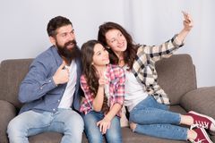 Selfie. Happy family at home. Modern smartphone. Little girl use smartphone with mother and father. bearded man and. Selfie. Happy family at home. Modern stock photos