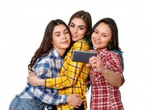 Selfie - Happy teenagers woman taking pictures by themselves isolated on white background royalty free stock photo