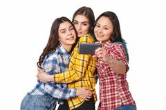 Selfie - Happy teenagers woman taking pictures by themselves isolated on white background royalty free stock image