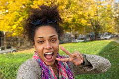 Selfie of a happy woman with showing peace sign Royalty Free Stock Photo