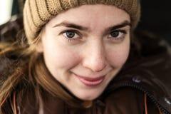 Selfie of happy woman in a woolen hat Stock Images