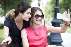 Selfie, Happy young women taking pictures on your phone Stock Photo