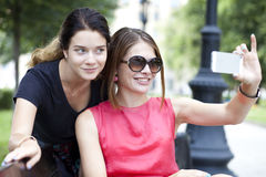Selfie, Happy young women taking pictures on your phone Royalty Free Stock Photography