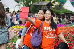 Selfie at Hong Kong Flower Show. Hong Kong Flower Show 2015 (from 20 to 29 March 2015 at Victoria Park in Causeway Bay). The Hong Kong Flower Show is a major Stock Photography