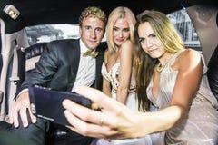 Selfie i limousine Arkivfoton