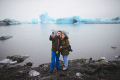 Selfie in Iceland. Couple making selfie in fron of lake with ice in Iceland Stock Image