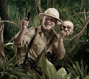 Selfie in the jungle with skull Stock Photography