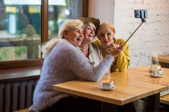 Selfie of ladies in cafe. Royalty Free Stock Photo