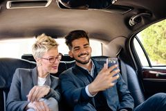 Selfie in limousine. Young business people Stock Photo