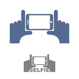 Selfie Logo. Sign emblem for a photo on phone. Hands and a Smart Stock Image