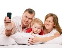 Selfie lycklig familj arkivfoto