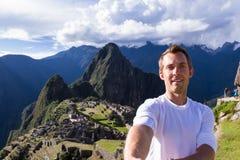 Selfie in Machu pichu. Machu Pichu, Peru - May 16 : Young man taking a selfie with Machu Pichu in the background. May 16 2016, Machu Pichu Peru stock photos