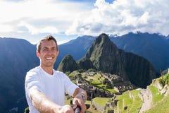 Selfie in Machu pichu. Machu Pichu, Peru - May 16 : Young man taking a selfie with Machu Pichu in the background. May 16 2016, Machu Pichu Peru stock photo