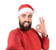 Selfie of man in santa hat showing okay sign royalty free stock photos