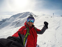 Selfie of man on snowy mountain Royalty Free Stock Image