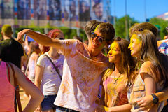 Selfie memory. People take pictures of yourself after a concert in celebration of Holi colored powder, Volgograd June 2015 Stock Photos
