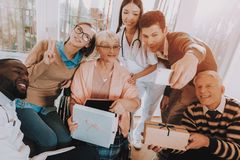 Selfie.Mobile Phone. Birthday Party. Celebration. Mobile Phone Birthday Party Celebration Balloons. Guests. Young and Old People. Nursing Home. Congratulate royalty free stock photo