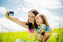 Selfie - mother, child and kitten Stock Photos