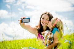 Selfie - mother, child and kitten Royalty Free Stock Photos