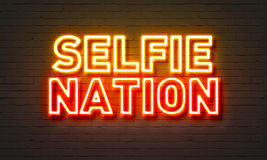 Selfie nation neon sign on brick wall background. Royalty Free Stock Photo
