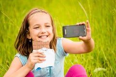 Selfie - niño con el chocolate Fotos de archivo libres de regalías