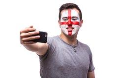 Selfie no telefone de fan de futebol do inglês no apoio do jogo de equipas nacionais de Inglaterra Imagens de Stock Royalty Free