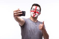 Selfie no telefone de fan de futebol do inglês no apoio do jogo de equipas nacionais de Inglaterra Foto de Stock Royalty Free
