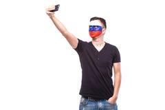 Selfie no telefone de fan de futebol do russo no apoio do jogo da equipa nacional de Rússia Fotografia de Stock Royalty Free
