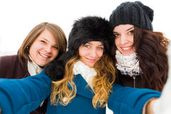 Selfie outdors. Girls taking a selfie outdoors in wintertime, having fun Stock Photography