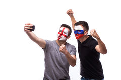 Selfie on phone of Englishman and Russian football fans in game supporting of national teams on white background. Stock Image