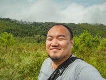 Selfie Photo of asian fat trekker on Khao Luang mountain in Ramkhamhaeng National Park. Sukhothai province Thailand stock photography