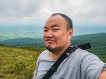 Selfie Photo of asian fat trekker on Khao Luang mountain in Ramkhamhaeng National Park. Sukhothai province Thailand royalty free stock photo