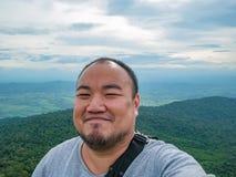 Selfie Photo of asian fat trekker on Khao Luang mountain in Ramkhamhaeng National Park. Sukhothai province Thailand royalty free stock images
