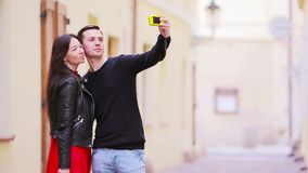 Selfie photo by caucasian couple traveling in Europe. Romantic travel woman and man in love smiling happy taking self stock video