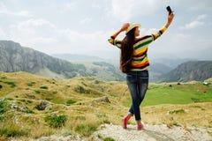 Selfie photo long hair girl taking on smartphone in  mountain vi Stock Image