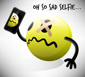 Selfie photo of sad emoticon character with mobile smart phone Stock Photography