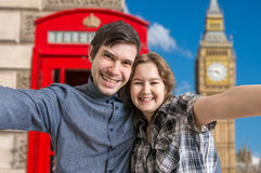 Selfie photo of young happy couple travelling in London Stock Images