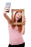 Selfie with picture frame Royalty Free Stock Photography