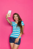 Selfie On Pink Background Royalty Free Stock Image