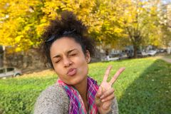 Selfie portrait of a cute girl making face Stock Photography