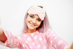 Selfie portrait of cute young woman in pajamas and sleep mask. Woke up in the morning. Charge of vivacity royalty free stock photos