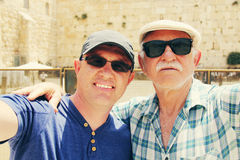 Selfie portrait of father and adult son near the Western Wall in Stock Images