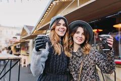 Selfie portrait of joyful fashionable girls having fun on sunny street in city. Stylish look, having fun, travelling royalty free stock images