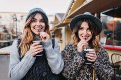 Selfie portrait of joyful fashionable girls having fun on sunny street in city. Stylish look, having fun, travelling royalty free stock photography