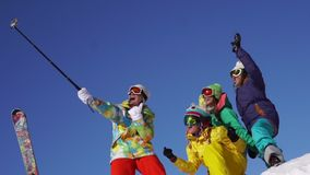 Selfie portrait messaging winter ski skiing snow vacation . Slow-motion shot stock video