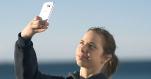 Selfie portrait photo on mobile cell phone camera stock video
