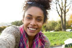 Selfie portrait of a smiling young woman Royalty Free Stock Images