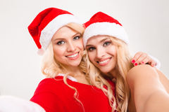 Selfie portrait of two lovely charming blonde sisters twins Royalty Free Stock Photos
