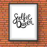 Selfie Queen Phrase in a Frame on Brick Wall Royalty Free Stock Photo