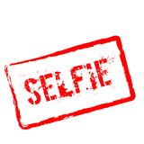 Selfie red rubber stamp isolated on white. Selfie red rubber stamp isolated on white background. Grunge rectangular seal with text, ink texture and splatter and Royalty Free Stock Images